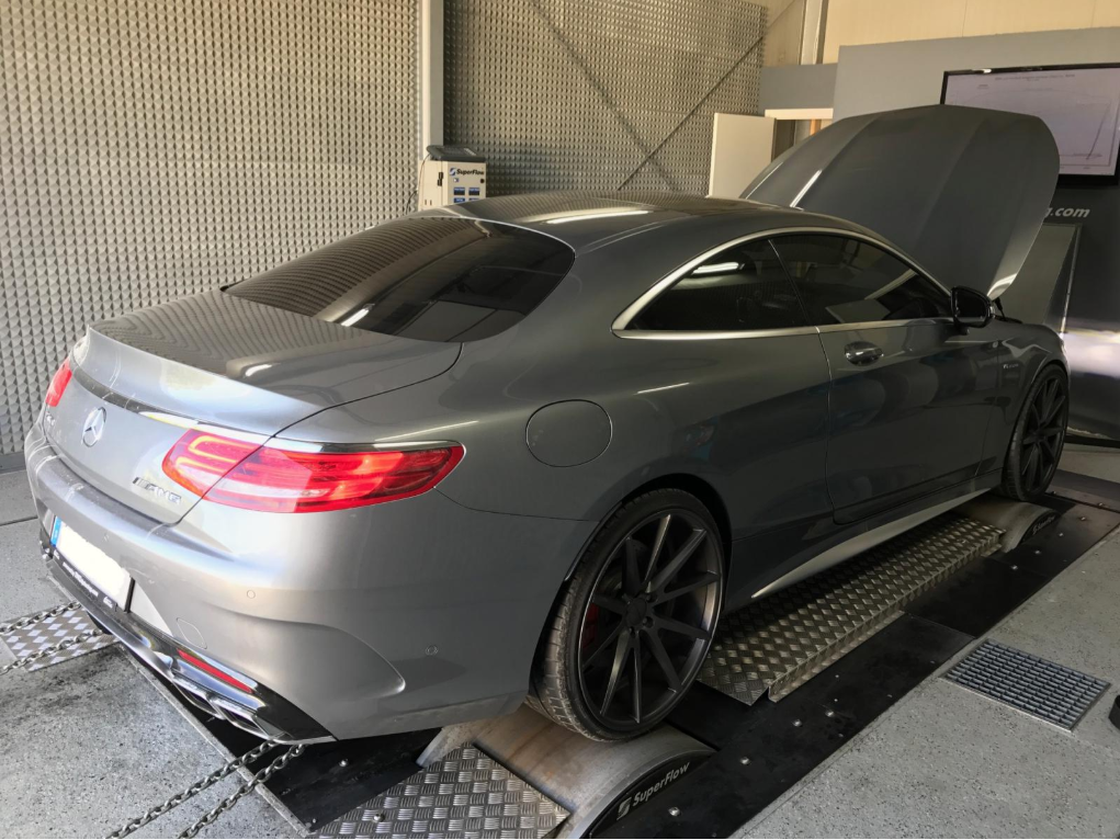 Gray Mercedes-Benz car in an engine testing facility