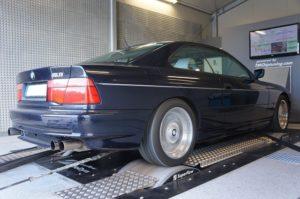 Blue BMW car in an engine testing facility