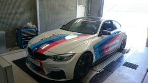 BMW sports car in an engine testing facility