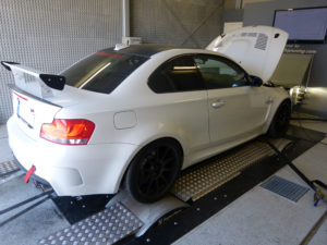 White BMW car in an engine testing facility