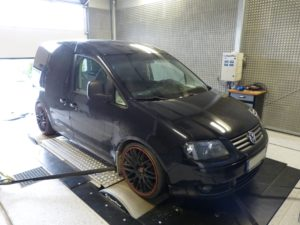 Black Volkswagen car in an engine testing facility