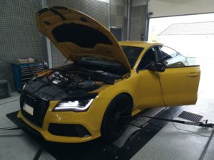 Yellow Audi car in an engine testing facility