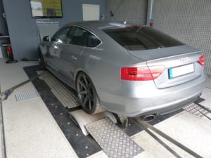 Gray Audi car in an engine testing facility